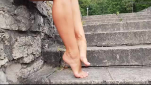 Blonde solo on sandals with high heels and foreplay
