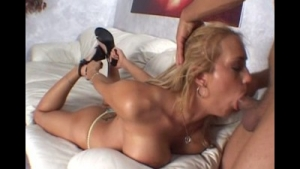 Young bitch with deep throat is sucking her neighbor's cock, while sucking another one