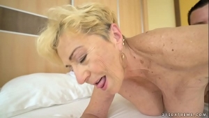 Busty woman is drilling her insatiable cunt with a sex toy, in front of a hidden camera